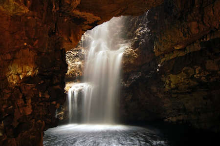 cascade: Waterfall in a cave Stock Photo