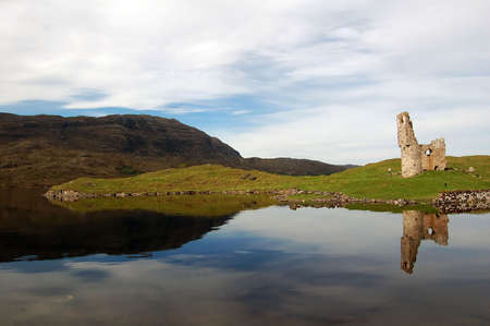Old castle reflected in lake