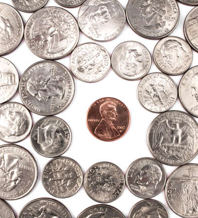 Single penny coin among large amount of other coins.