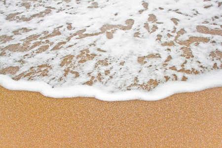 Closeup of sea wave on the sea shore.