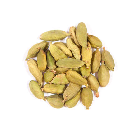 Small pile of cardamom isolated on white background. Stock Photo