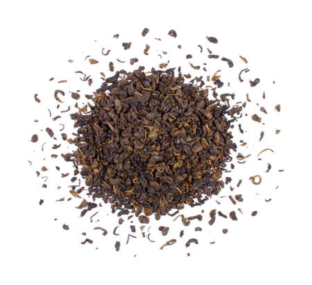 The pile of the dry tea leaves isolated on white background.