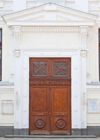 Retro wooden museum doors in the afternoon