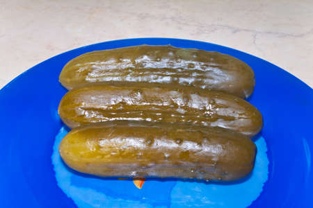Traditional Russian snack - marinated cucumbers