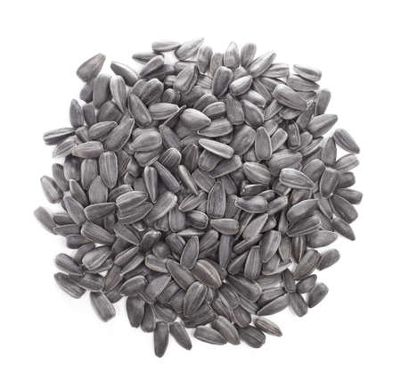 Small pile of sunflower seeds isolated on white background
