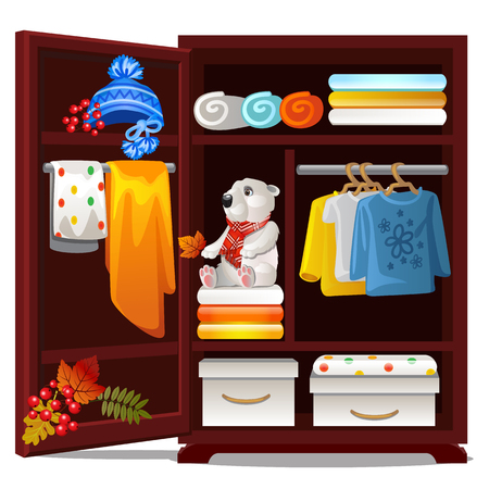 Wooden wardrobe with objects on the autumn theme isolated on white background. Warm wool autumn clothing, hats, towels, plush bear. Vector cartoon close-up illustration Vetores