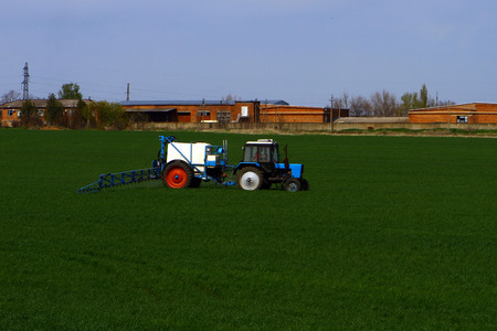 agricultural tenure: The modern tractor treats crops from parasites and insects Stock Photo