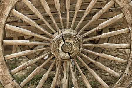 Old cracked wooden wheel closeup, the whole wheel is made of wood Stock Photo