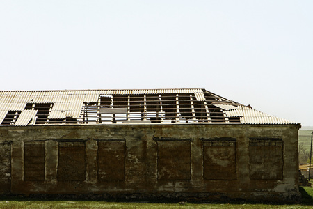 Ruined old cattle stable, damaged by time Standard-Bild - 100049607