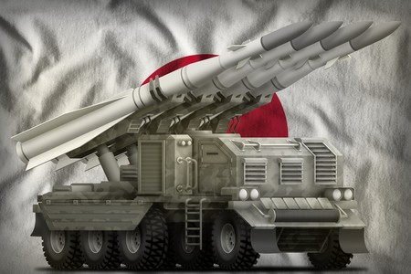 tactical short range ballistic missile with city camouflage on the Japan flag background. 3d Illustration