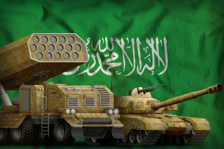 tank and rocket launcher with yellow camouflage on the Saudi Arabia flag background. Saudi Arabia heavy military armored vehicles concept. 3d Illustration