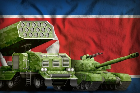 tank and rocket launcher with summer pixel camouflage on the Democratic Peoples Republic of Korea (North Korea) flag background. Democratic Peoples Republic of Korea (North Korea) heavy military armor