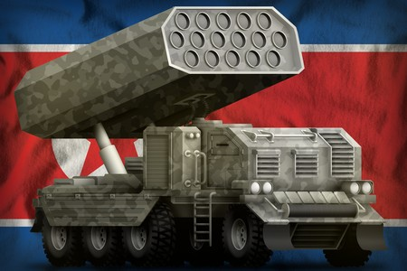 rocket artillery, missile launcher with grey camouflage on the Democratic Peoples Republic of Korea (North Korea) flag background. 3d Illustration