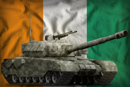 heavy tank with city camouflage on the Cote d Ivoire flag background. 3d Illustration Фото со стока