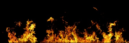 Real fire line flames isolated on black background. Mockup fire wall. Stock Photo