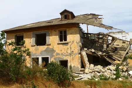 RUSSIA, CRIMEA, KERCH - MAY 27, 2018: razed old house. Architecture image. illustrative editorial