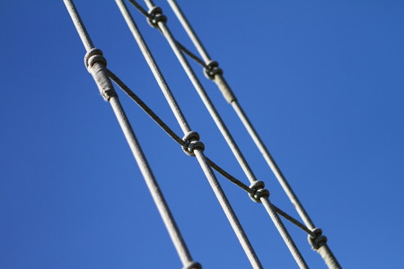 Image of mast of ship with rigging and ropes, sky and copy space - objects photo