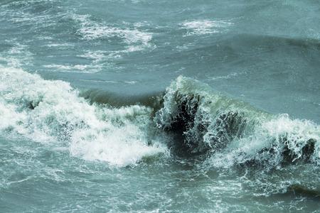 Slightly toned blue sea waves, natural texture photo 版權商用圖片