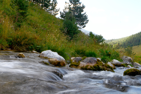 Photo of nature - spring water mountain river shot with long exposure and the wonderful petrous creek on North Caucasus