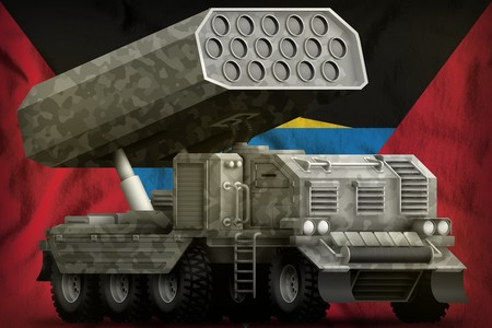 rocket artillery, missile launcher with grey camouflage on the Antigua and Barbuda flag background. 3d Illustration