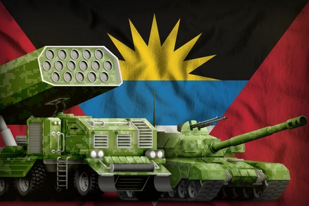 tank and rocket artillery with summer pixel camouflage on the Antigua and Barbuda flag background. Antigua and Barbuda heavy military armored vehicles concept. 3d Illustration