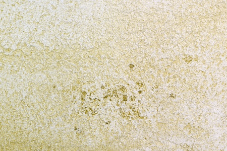 creative aged yellow travertine like stucco texture for use as background.