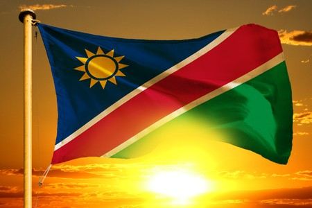Namibia flag weaving on the beautiful orange sunset background