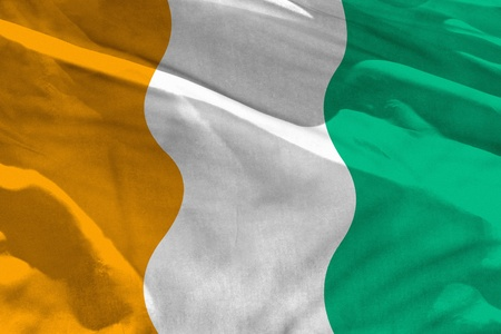 Fluttering Cote d Ivoire flag for using as texture or background, the flag is waving on the wind