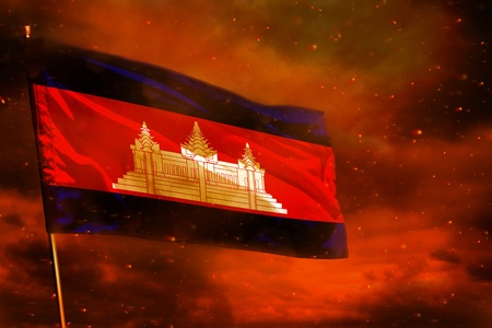 Fluttering Cambodia flag on crimson red sky with smoke pillars background. Cambodia problems concept.