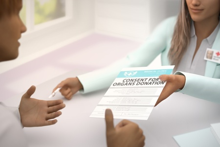 Nice female medical doctor in her office gives patient consent for organs donation and patient  gladly accepts it, he likes it and shows thumb up gesture - medical illustration with selective focus, 3D illustration