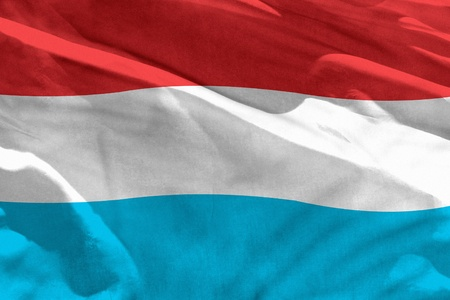Fluttering Luxembourg flag for using as texture or background, the flag is waving on the wind