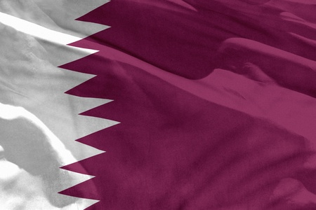 Fluttering Qatar flag for using as texture or background, the flag is waving on the wind Stock Photo - 113166557