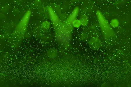 green fantastic sparkling abstract background stage spotlights with sparks fly defocused bokeh - holiday mockup texture with blank space for your content