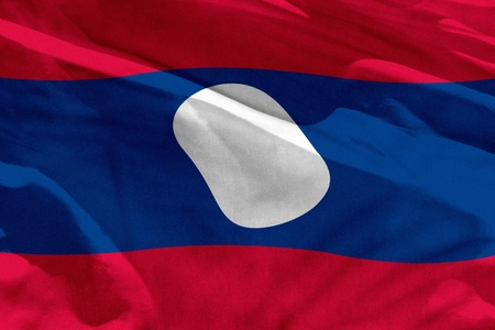 Fluttering Lao People Democratic Republic flag for using as texture or background, the flag is waving on the wind