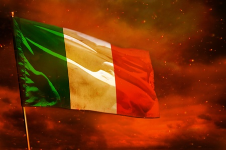 Fluttering Italy flag on crimson red sky with smoke pillars background. Italy problems concept.