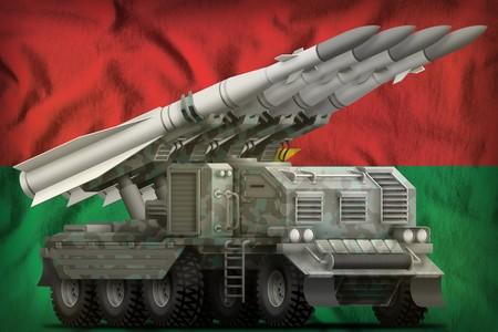 tactical short range ballistic missile with arctic camouflage on the Burkina Faso flag background. 3d Illustration Banco de Imagens
