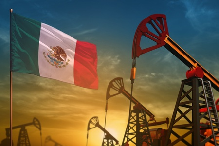 Mexico oil industry concept, industrial illustration. Fluttering Mexico flag and oil wells on the blue and yellow sunset sky background - 3D illustration