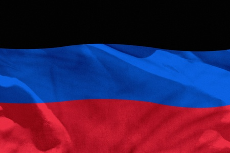 Fluttering Donetsk Peoples Republic flag for using as texture or background, the flag is waving on the wind