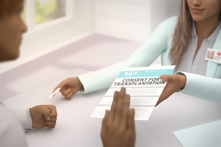 pretty lady medical doctor gives patient consent for transplantation and patient  do not accept it - declines it and refuses to take it - medical illustration with selective focus, 3D illustration Stock Photo