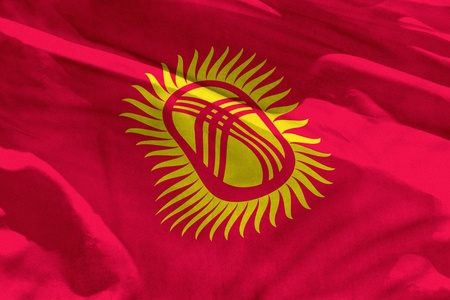 Fluttering Kyrgyzstan flag for using as texture or background, the flag is waving on the wind