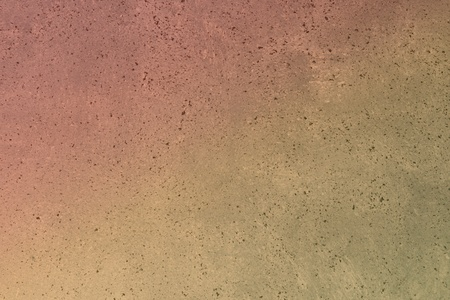 wonderful red spotted striped stucco on the wall texture - abstract photo background