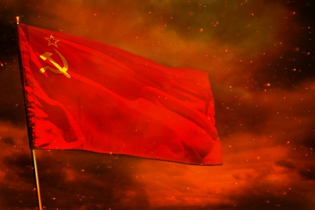 Fluttering Soviet Union (SSSR, USSR) flag on crimson red sky with smoke pillars background. Soviet Union (SSSR, USSR) problems concept. Reklamní fotografie