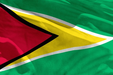 Fluttering Guyana flag for using as texture or background, the flag is waving on the wind