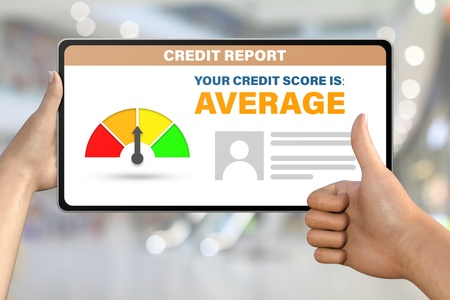 average credit score technology concept - hand with tablet pc shows like, thumb up on bokeh business background Standard-Bild