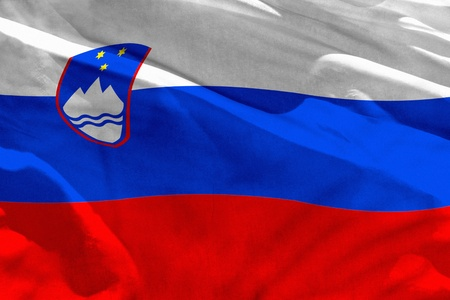 Fluttering Slovenia flag for using as texture or background, the flag is waving on the wind Foto de archivo