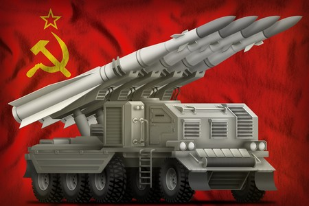 tactical short range ballistic missile on the Soviet Union (SSSR, USSR) flag background. 9 May, Victory day concept. 3d Illustration
