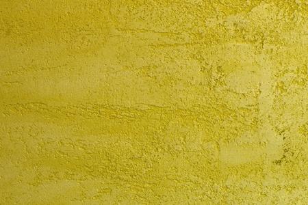 nice vintage yellow travertine like stucco texture for design purposes. Reklamní fotografie