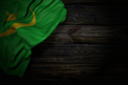 beautiful anthem day flag 3d illustration  - dark photo of Mauritania flag with large folds on old wood with empty place for your text