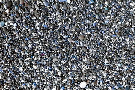 wonderful glossy sea pebbles wet by wave texture - abstract photo background
