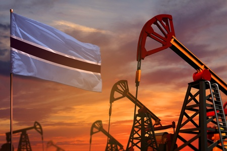 Botswana oil industry concept, industrial illustration. Botswana flag and oil wells and the red and blue sunset or sunrise sky background - 3D illustration